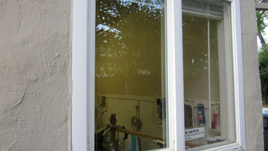 glass in window frame on house