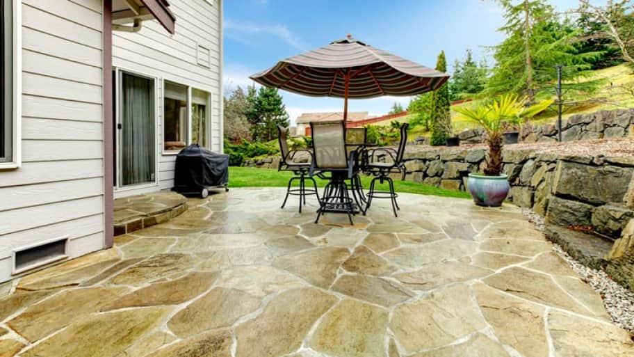Slab concrete backyard patio table chairs
