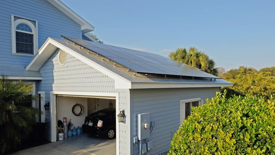 solar panels on garage with Prius inside