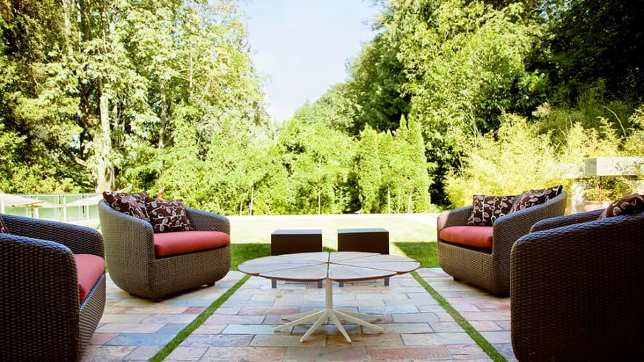 Modern patios with stone pavers and patio seating