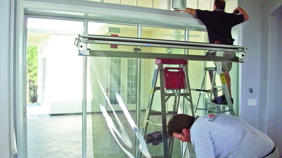 workers applying window film