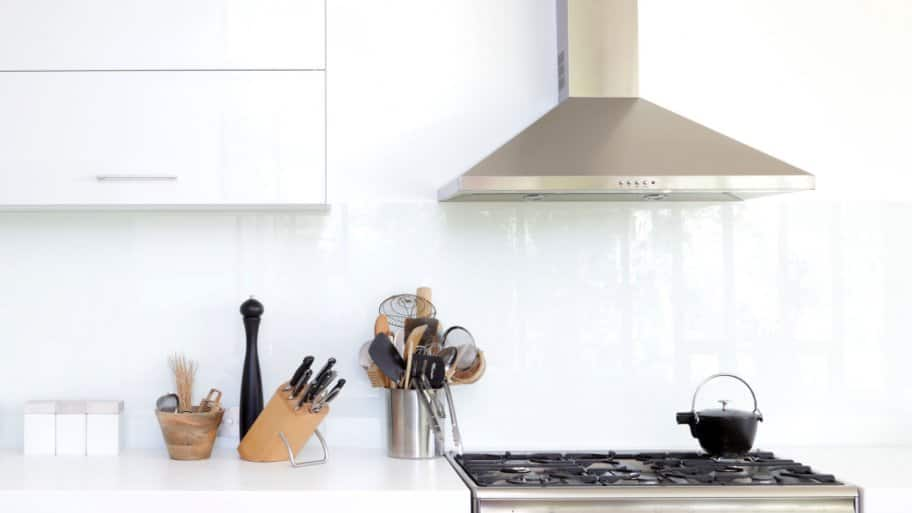 A white modern kitchen with a exhaust fan (Photo by Bloodstone/E+ via Getty Images)