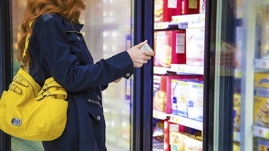 woman shopping in grocery store in freezer aisle