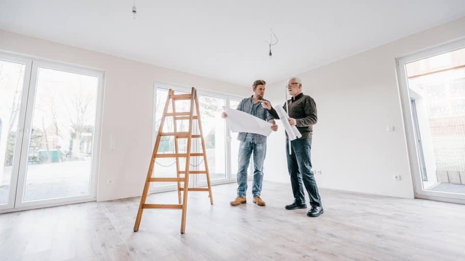 Architect checking plan with home owner.