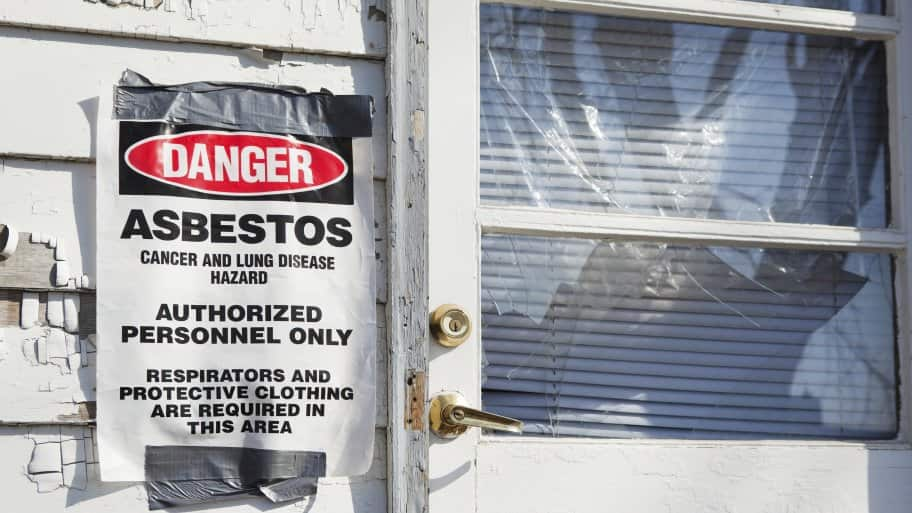danger asbestos sign posted on house