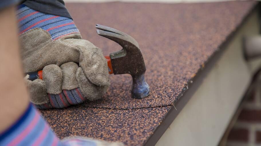 roofer working on asphalt roof