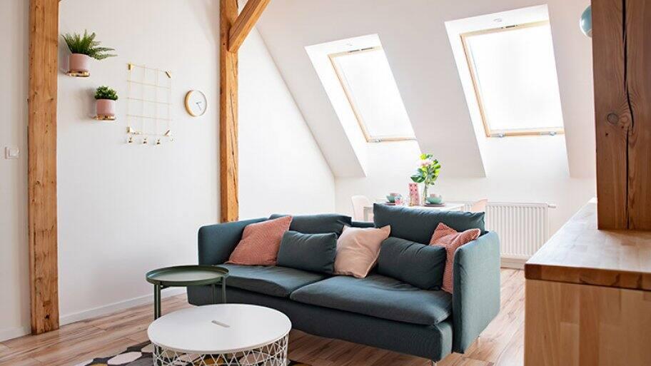 Cosy living room in an attic (Photo by Daniel Jędzura - stock.adobe.com)