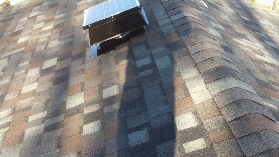 a solar powered attic fan on a roof