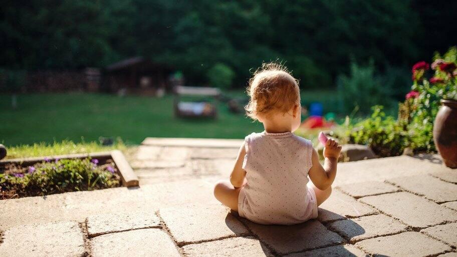 Baby sitting on paver patio