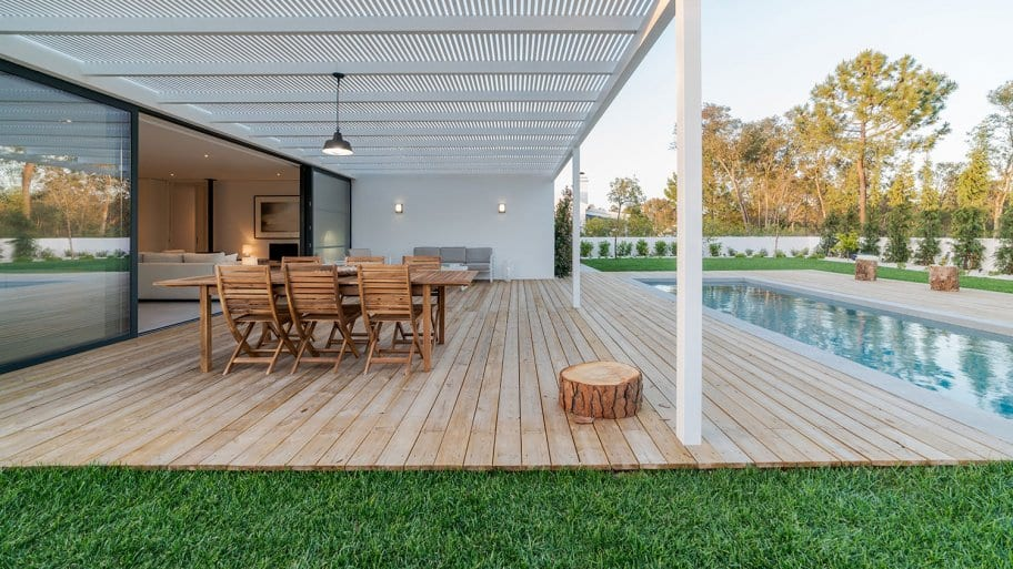 Modern home back patio with pool (Photo by Luis Viegas via Getty Images)