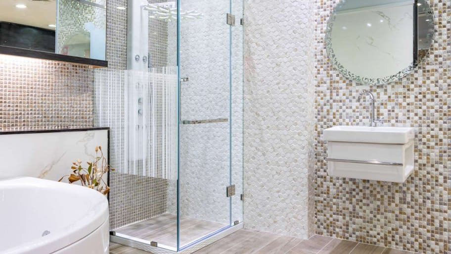 A bathroom with a shower cabin of glass