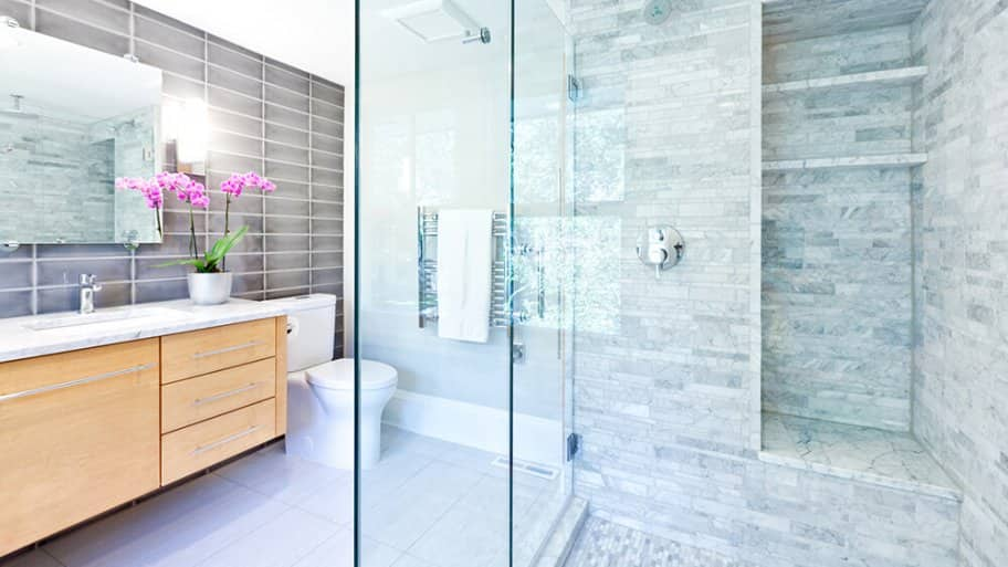 Bright contemporary bathroom with marble tiles