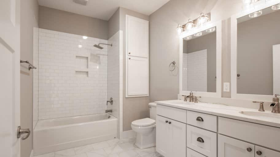 a white and beige modern bathroom with new shower/tub combo