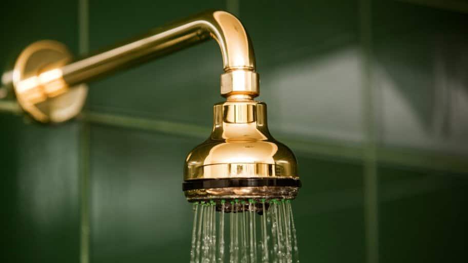 A shower head running water