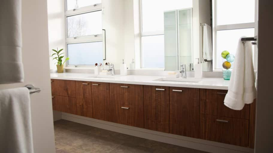 Bathroom interior with wooden cabinets