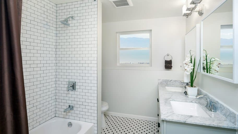 Renovated bathroom with white tile