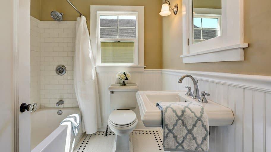Full bathroom with white tile