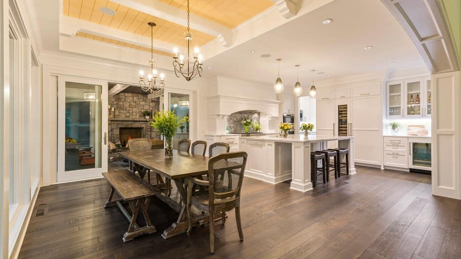 Dining area and kitchen with beautiful hanging lights (Photo by PC Photography / iStock / Getty Images Plus via Getty Images)