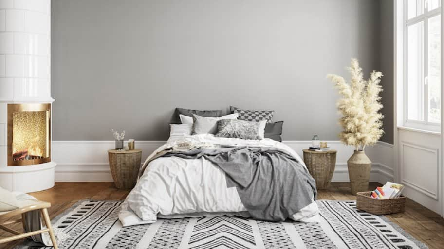 a furnished bedroom with gray walls