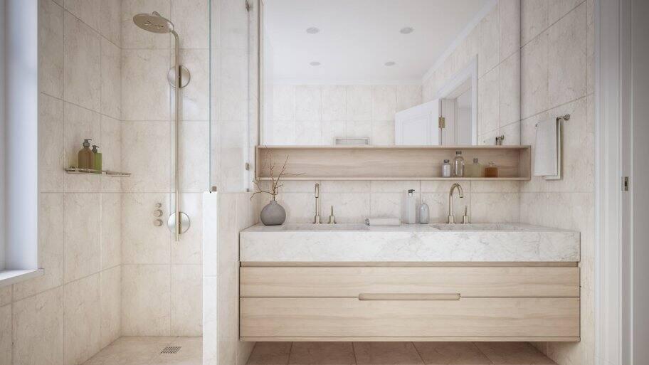 A beige colored modern bathroom