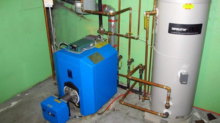 a blue boiler next to a gas tank