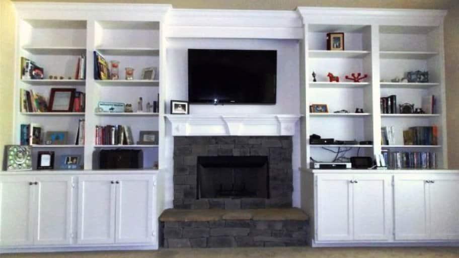 custom built-in bookshelves around living room fireplace