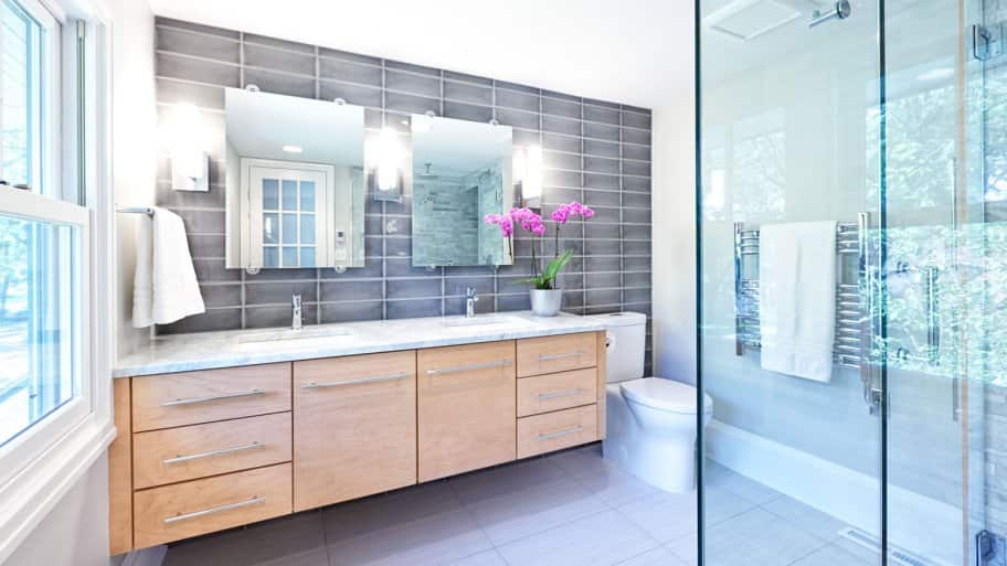 bathroom remodel two sinks and shower  (Photo by  YinYang/iStock/Getty Images Plus via Getty Images)