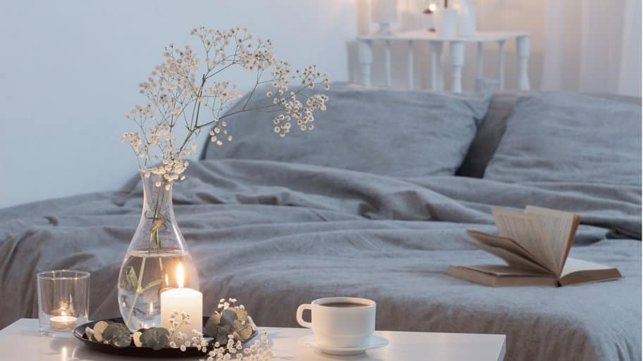 Candles burning in bedroom