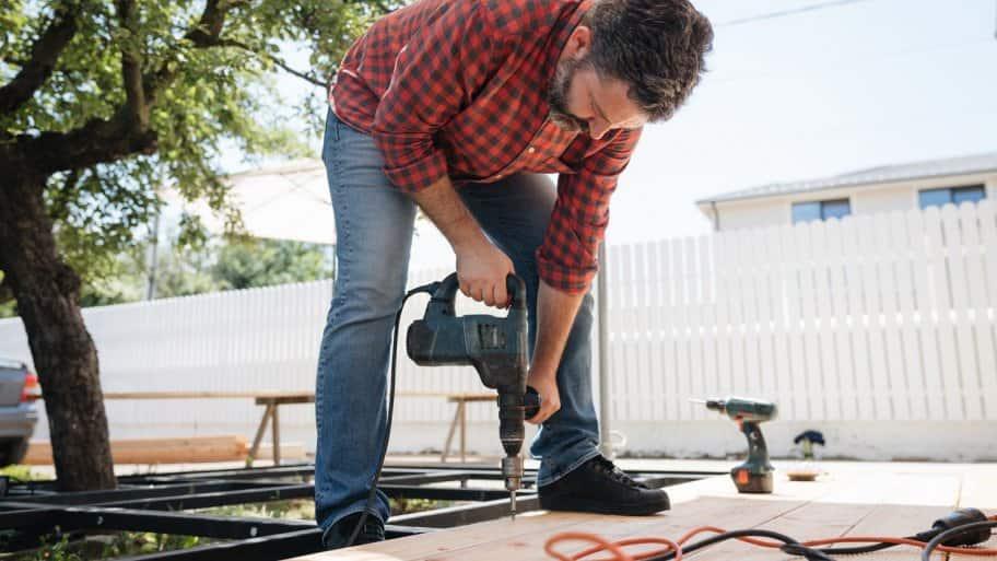 A carpenter installing a new wooden deck