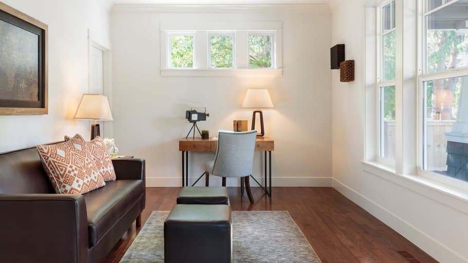 Clean office space in bright room overlooking front porch