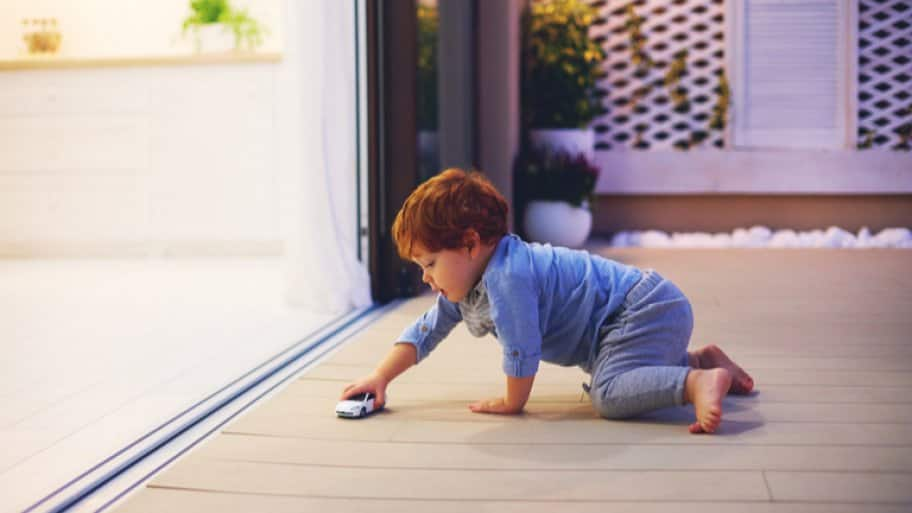child playing on outdoor patio