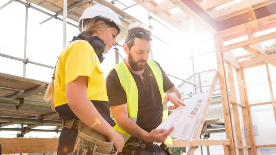 A contractor giving guidance to a worker