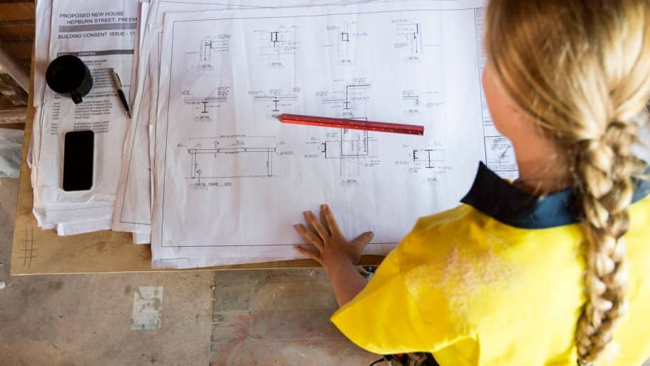 A female contractor looking at site plans