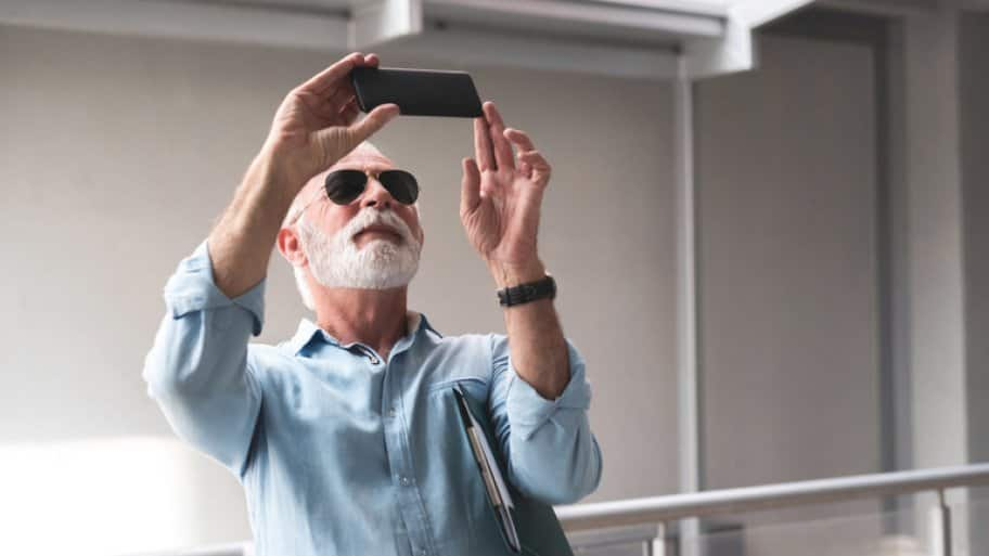 Contractor taking photos of project with smartphone