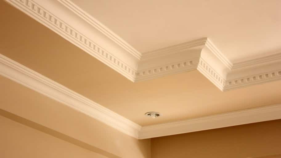 Elegant crown molding on a house's ceiling