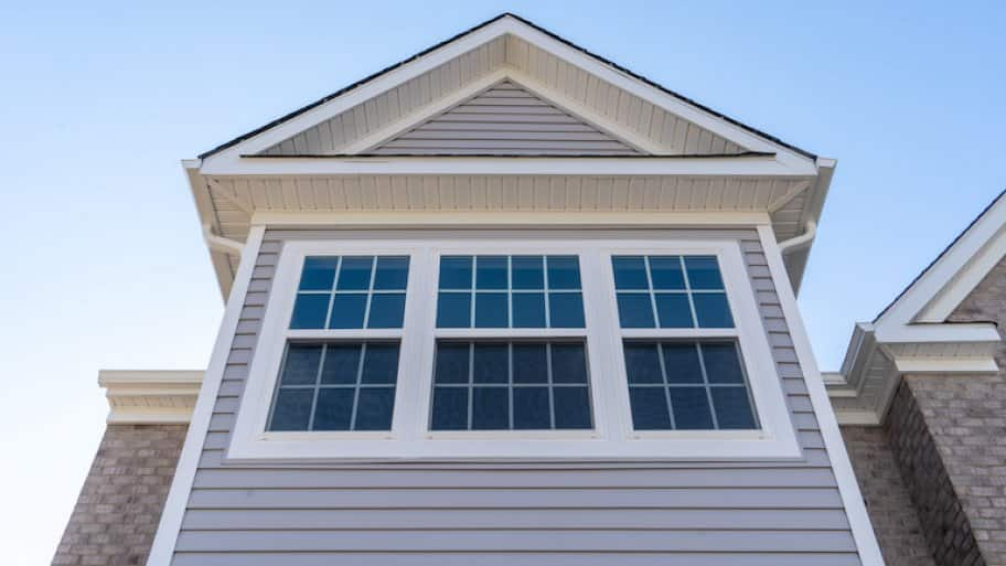 three double hung windows on front of house (Photo by © tamas - stock.adobe.com)