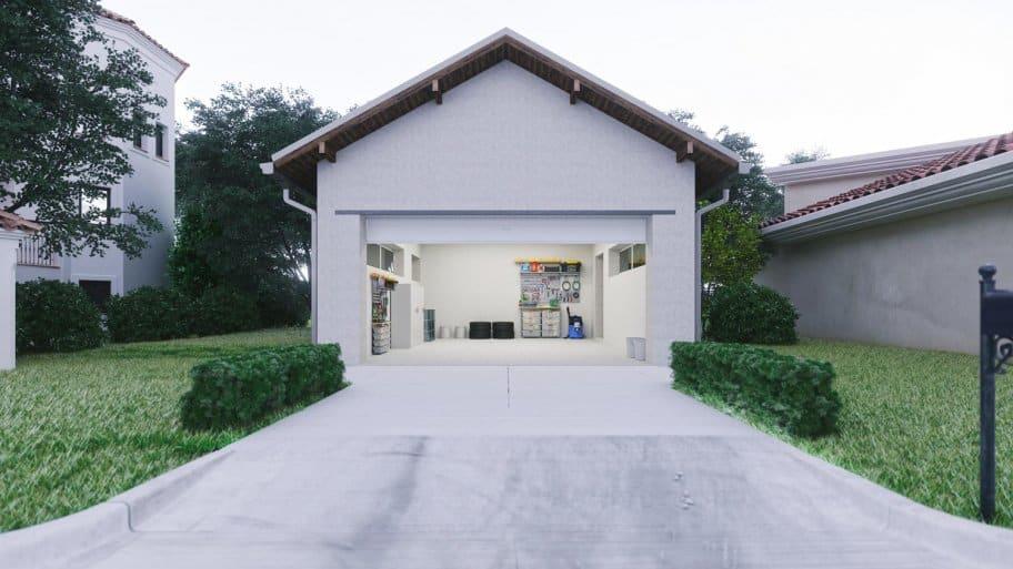 Concrete driveway leading to an open garage