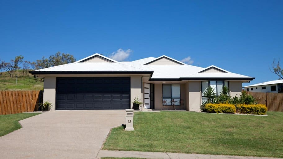 A modern, single story house with a driveway