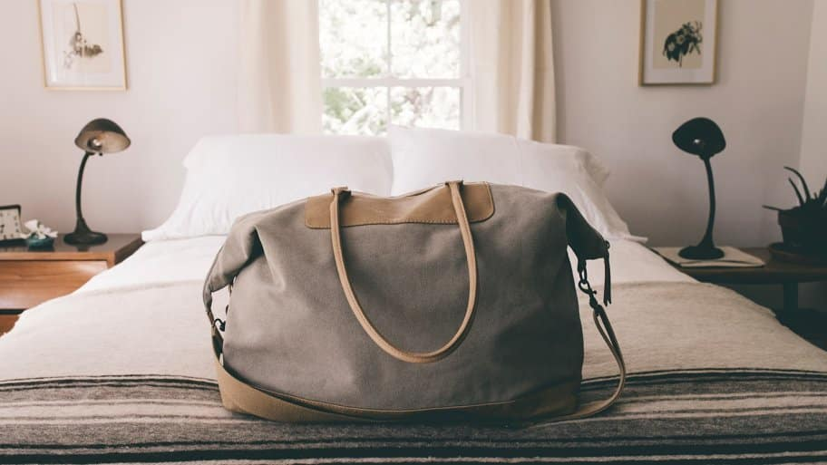 Duffle bag on bed