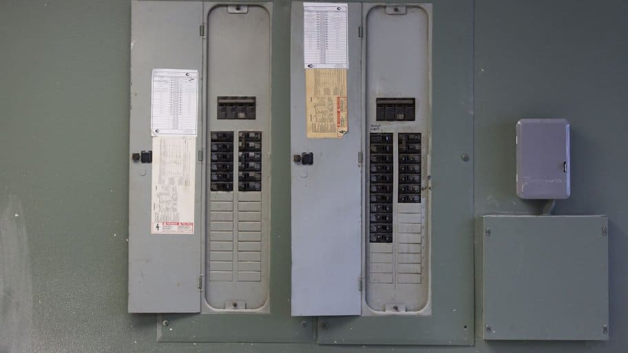 two gray electric panels side by side (Photo by Eldon Lindsay)