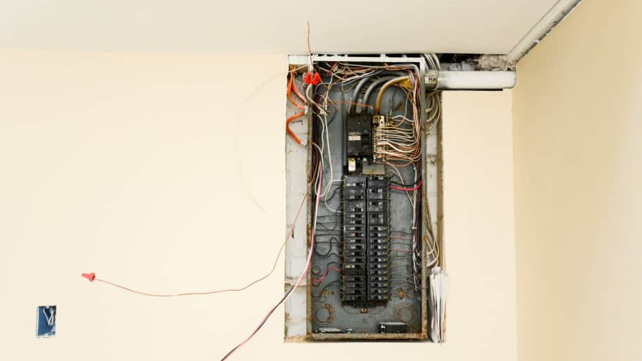circuit breaker box with wires hanging out