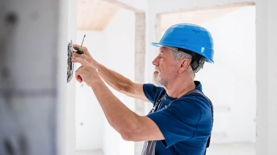 An electrician checking wiring in a house