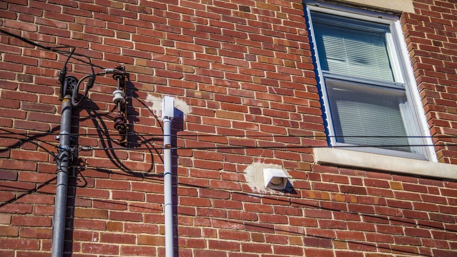 Electricity supply termination at the side of a building