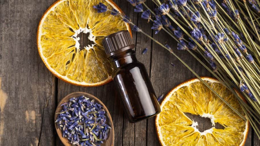 Essential oil lavender and orange dry on a wooden table, top view (Photo by © 5./15 WEST/Getty Images )
