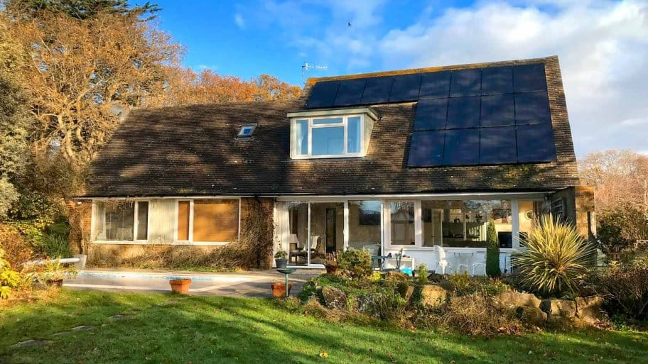 The exterior of a house with solar panels on its roof