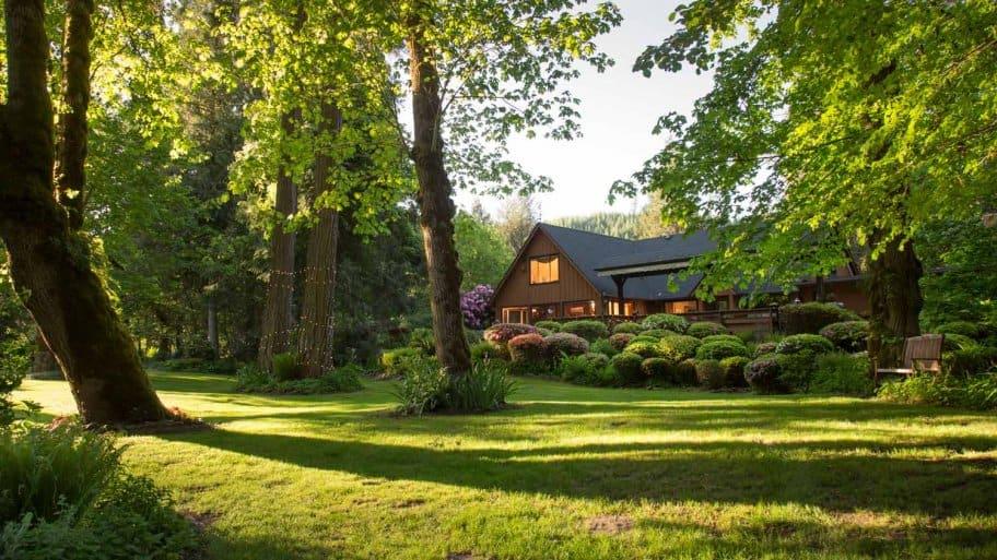 The facade of a house with lush gardens
