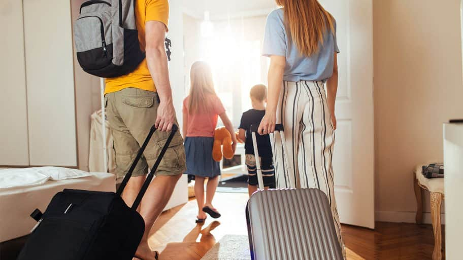 family leaving home for vacation
