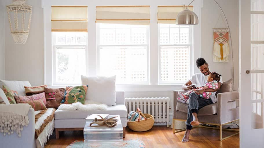 Father and daughter spending time together in their living room