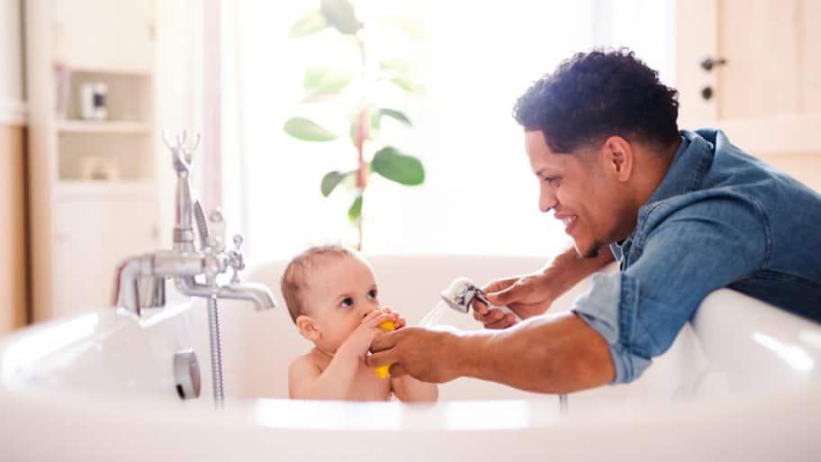 Father giving son a bath