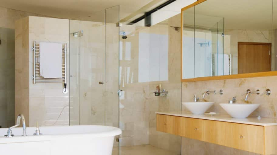 Frameless shower in a an open modern bathroom  (Photo by Martin Barraud/OJO Images via Getty Images)